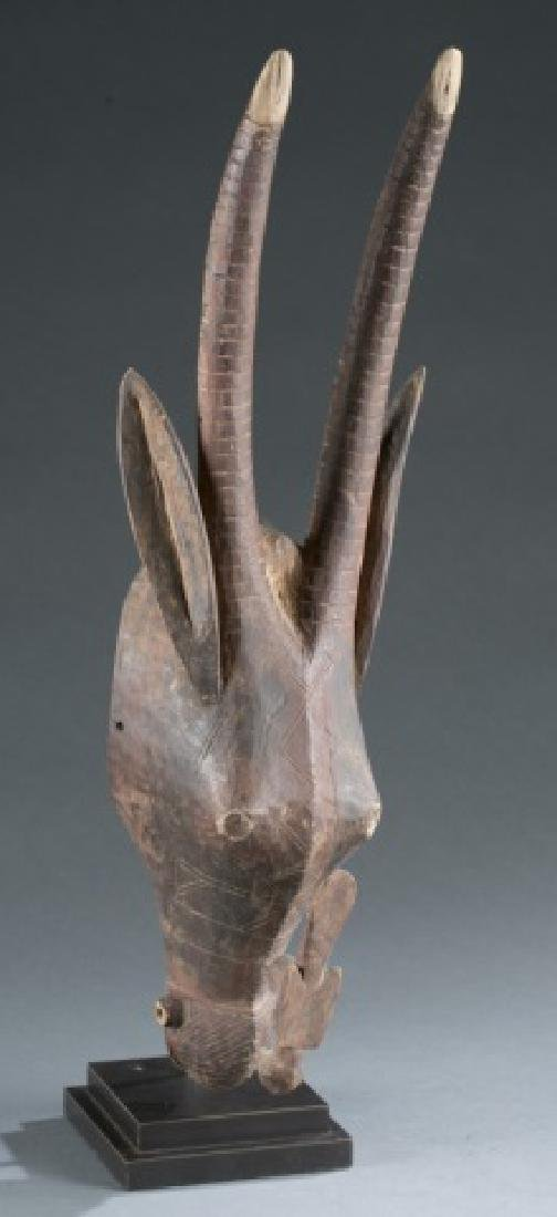 Antelope style headdress with carved bird figure.