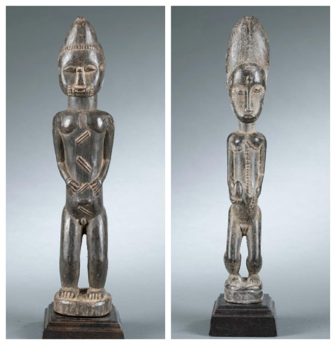 2 well carved Baule style figures. 20th century.