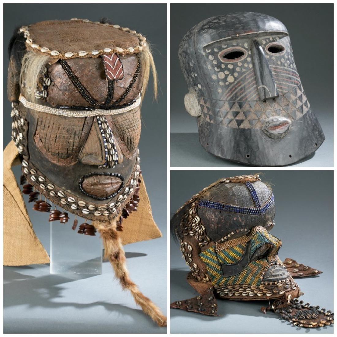 3 Kuba style helmet masks. c.20th century.