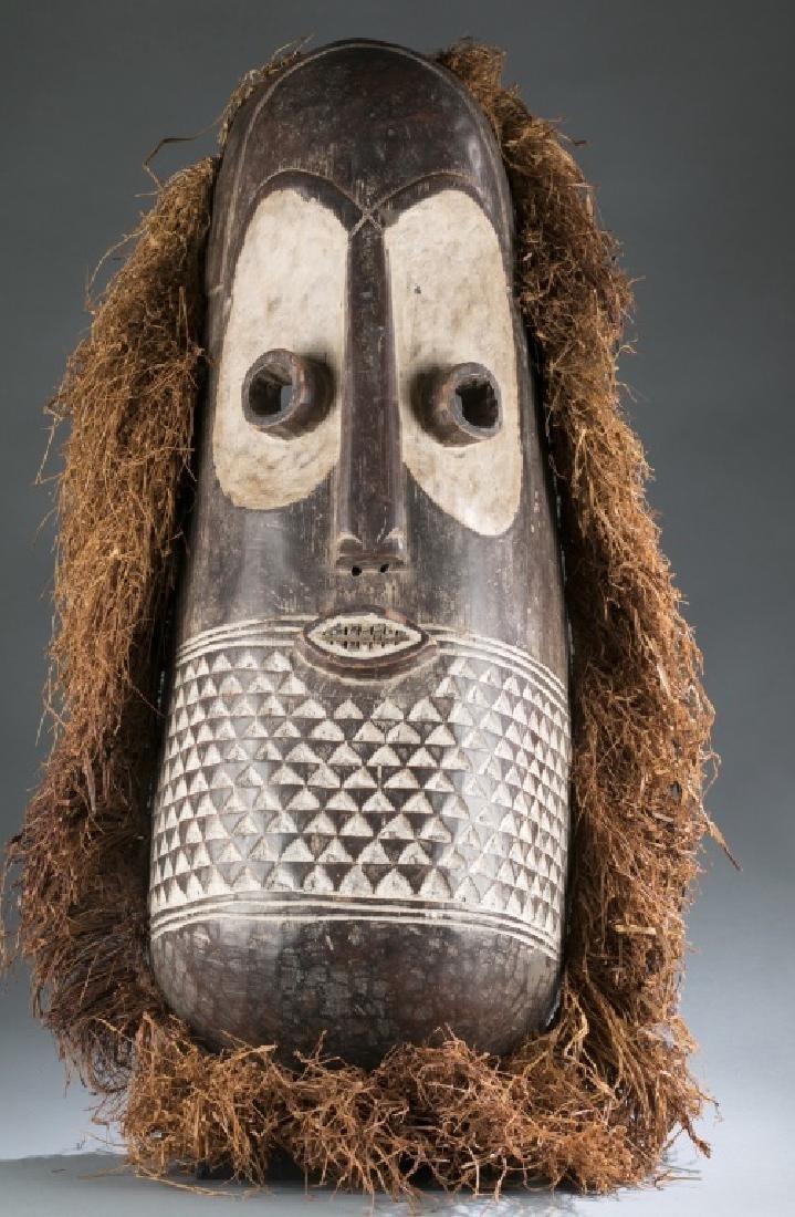 Congo style mask with raffia. C.20th.