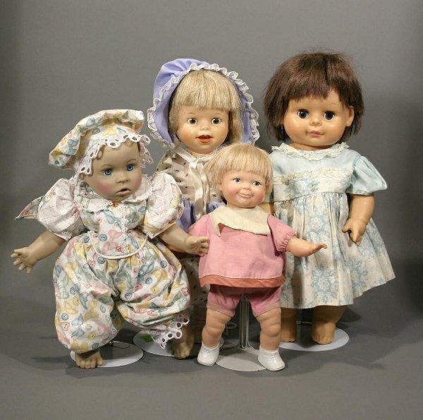 619: Lot of three rubber baby dolls & 1 hard plastic.
