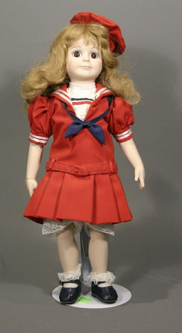 621: Betsy McCall porcelain with cloth body doll. From