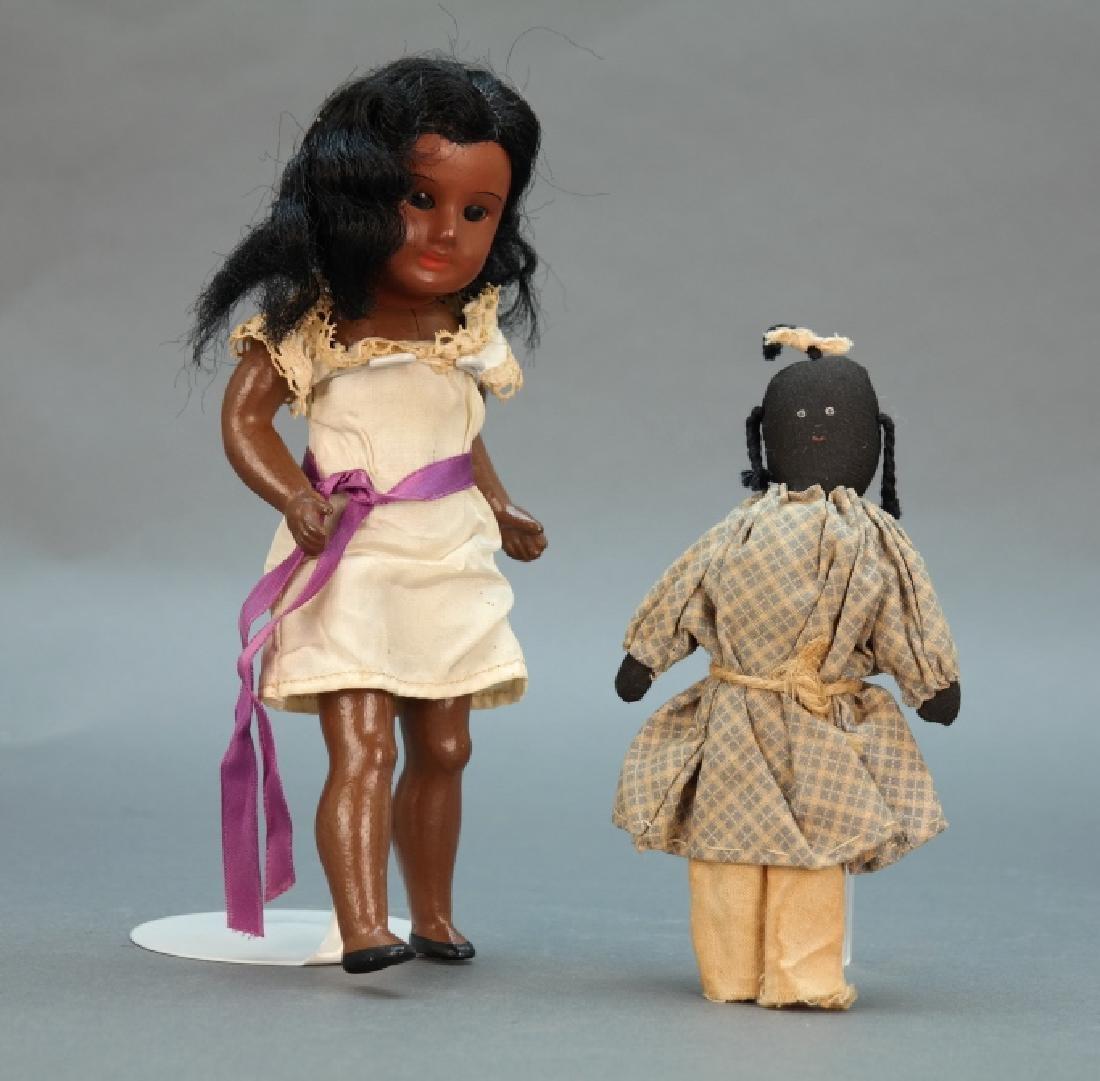 "2 Black Americana dolls, 1 with ""P.Q. '88."""