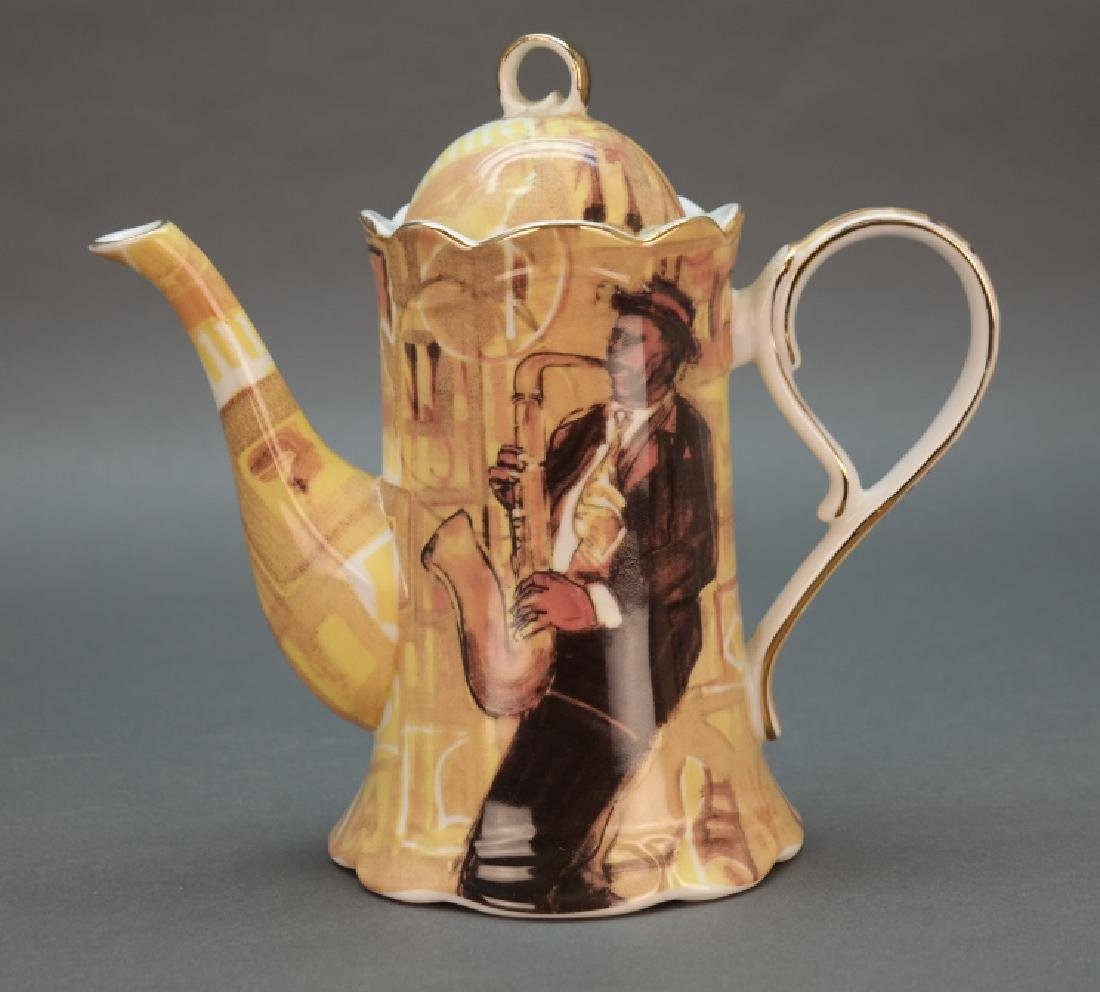 Black Americana coffee pot with saxophonist.