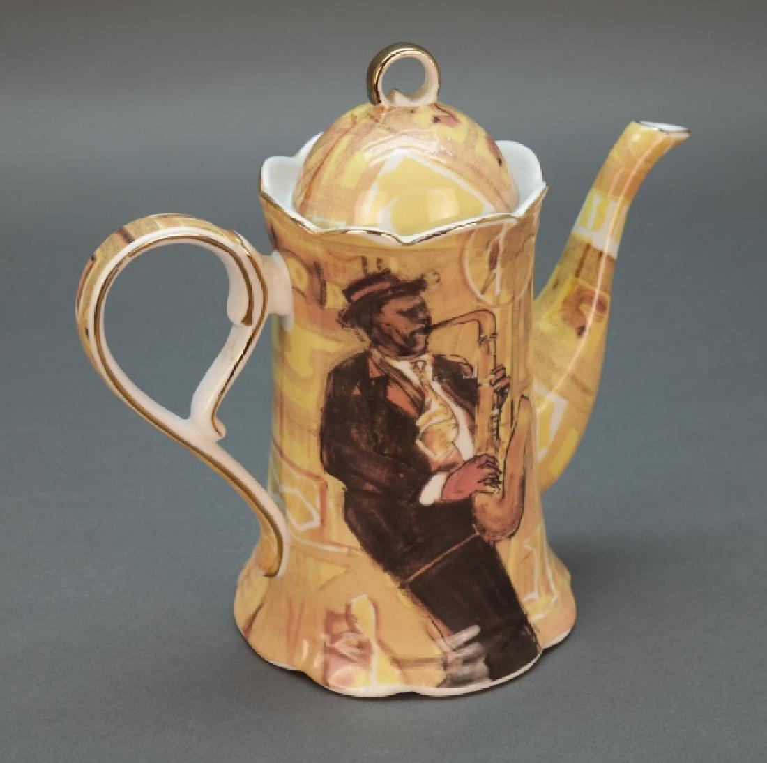 Black Americana coffee pot with saxophonist. - 2