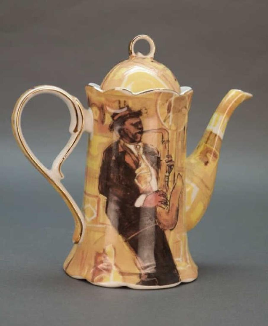 Black Americana coffee pot with saxophonist. - 3