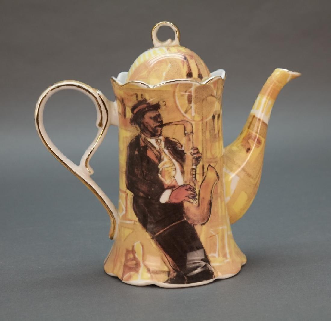 Black Americana coffee pot with saxophonist. - 4