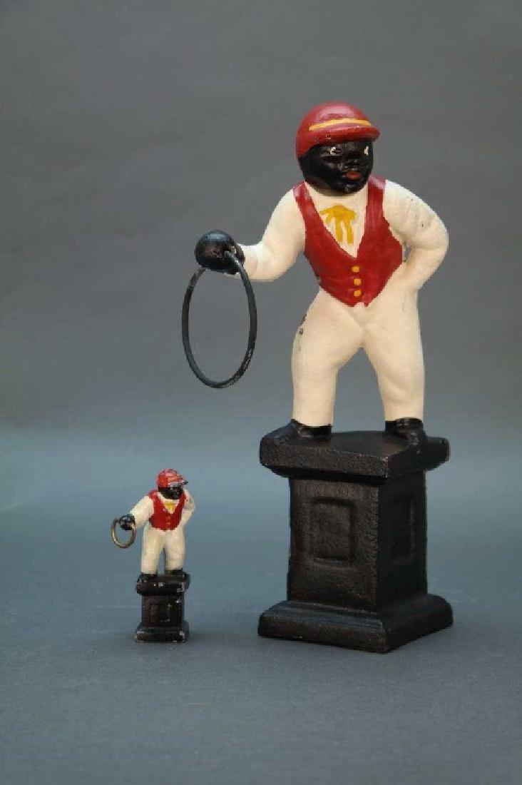 2 Black Americana statuettes.