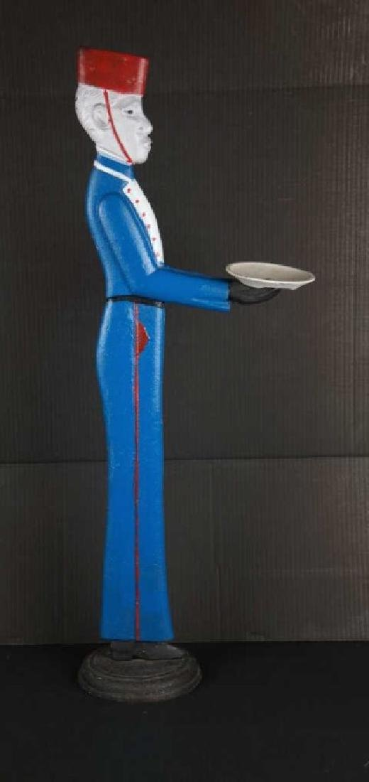 Painted metal bellhop for outdoor display.