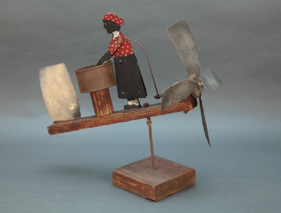 Folk-art whirligig showing a washerwoman.