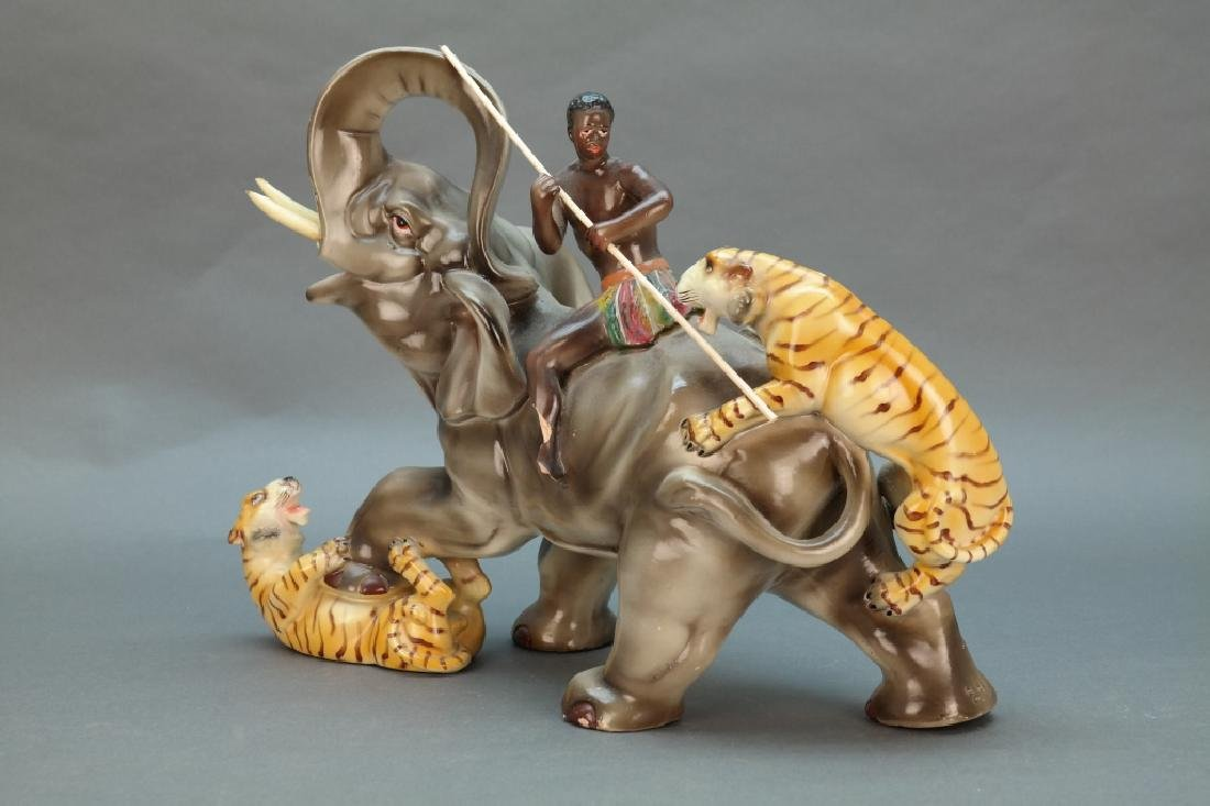 Statuette of African hunter/elephant w/ 2 tigers.