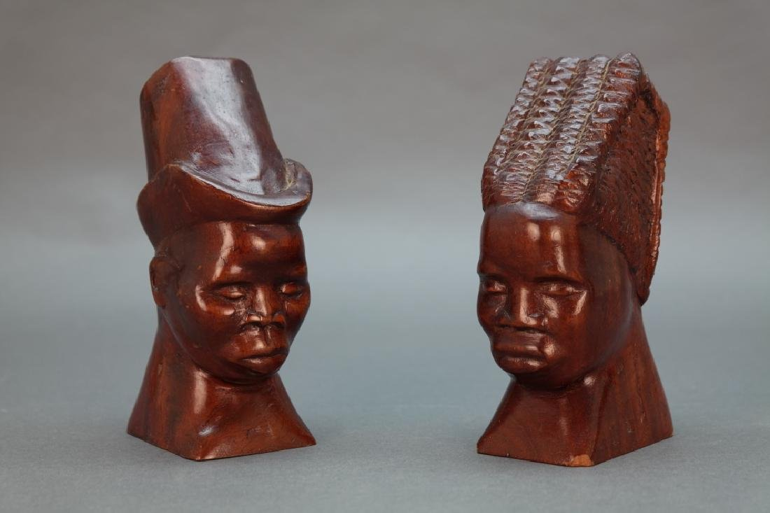 4 Black Americana carved wooden heads.