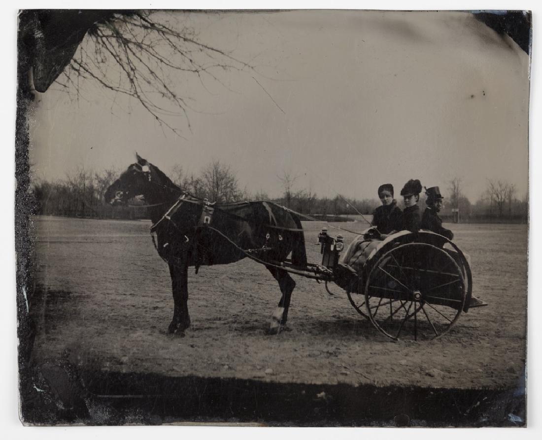 Tintype of horse, cart & passengers.