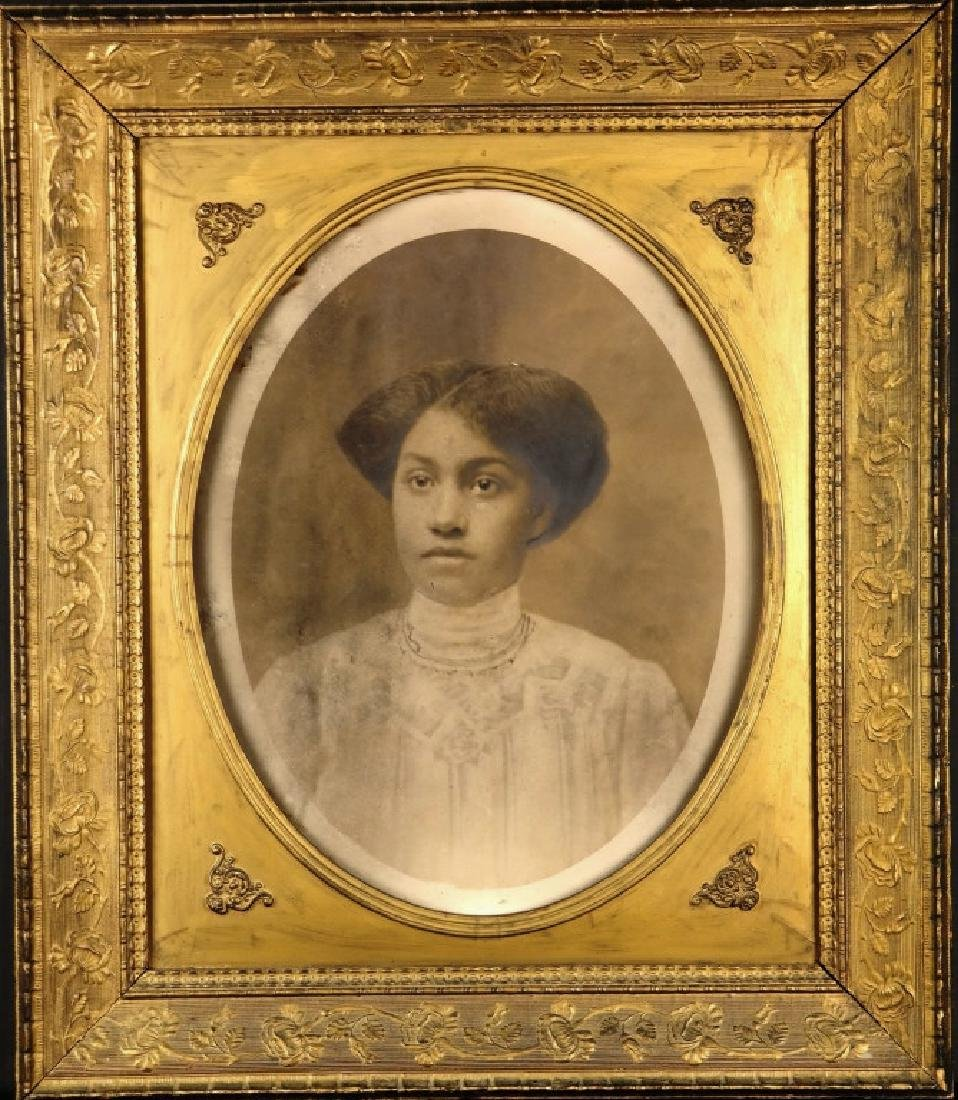 Sepia photograph of a young black woman, c.1900