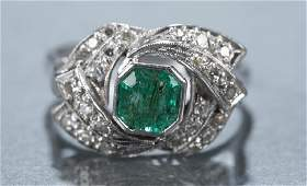 Art Deco emerald and diamond cocktail ring.