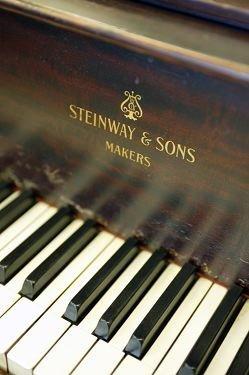 225: 1914 Steinway & Sons mahogany grand piano.