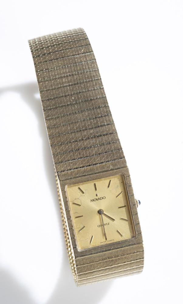 Movado 14k gold wristwatch.