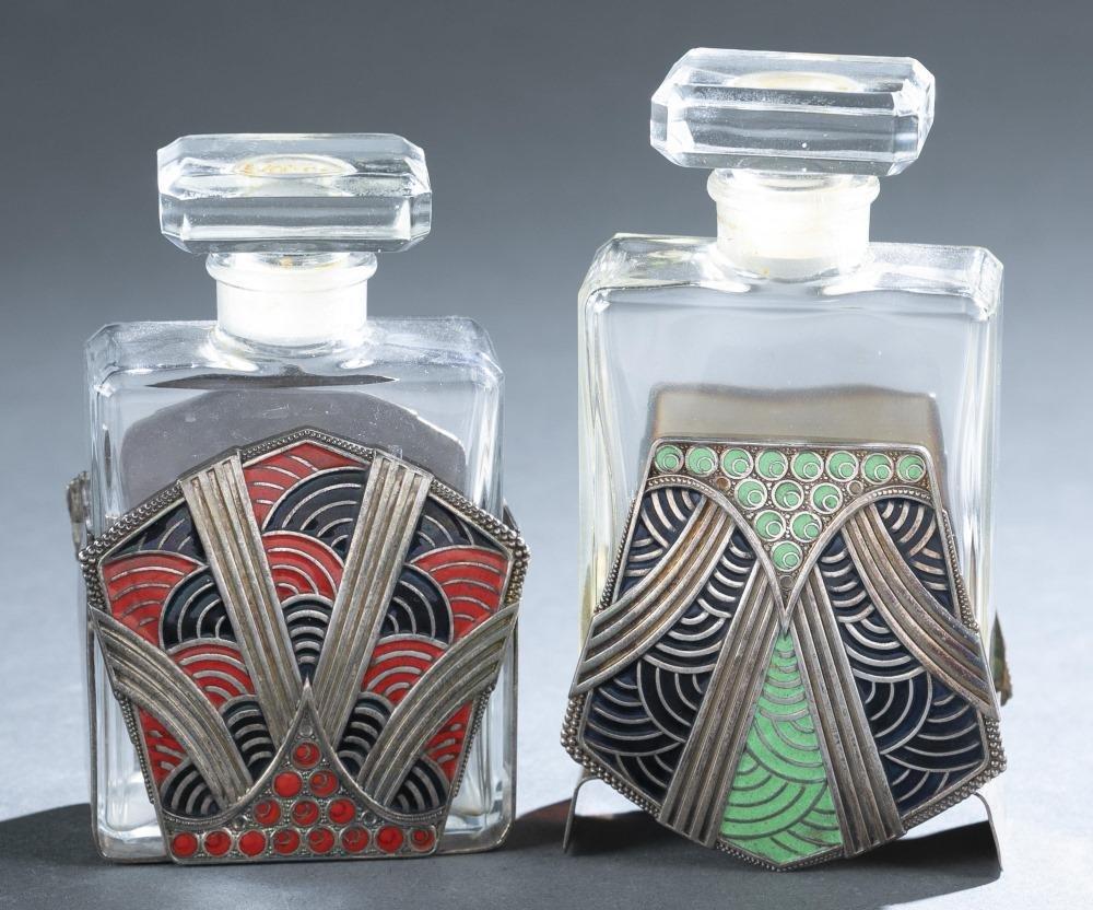 2 Chanel bottles in dresser holders.
