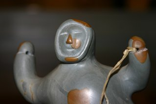 3009: Small Inuit carved stone Fisherman statue.