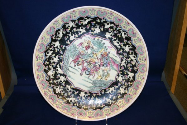 3021: Large hand painted Asian charger. Signed o