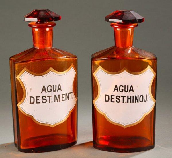 3024: Pair of  pharmacy bottles of amber glass,
