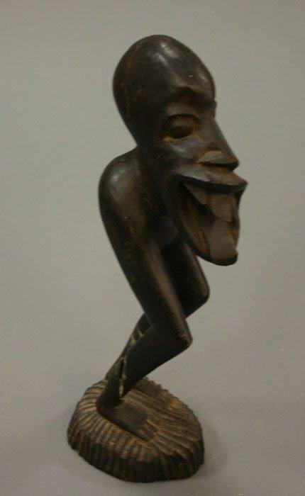 4001: African carvings man eating bird