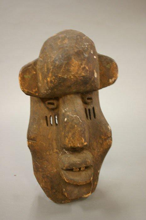 4005: African carved wood mask teeth