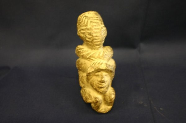 4010: African stone carving of three figures. 2