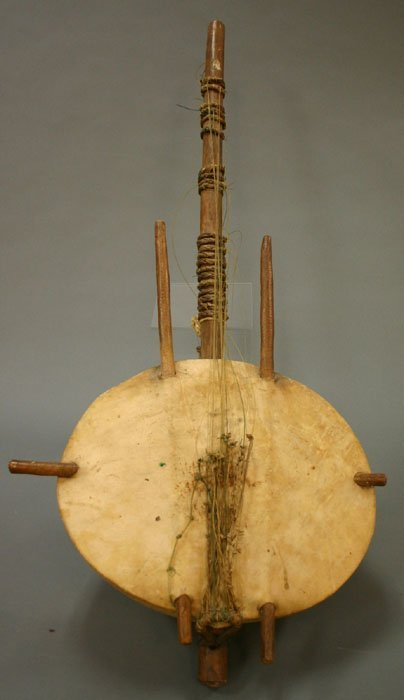 4020: African guitar wood and hide. 20th centur