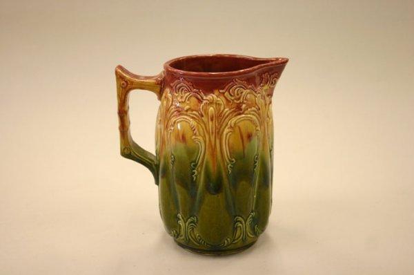 3002: Multi-colored Majolica pitcher. Late 19th-ear