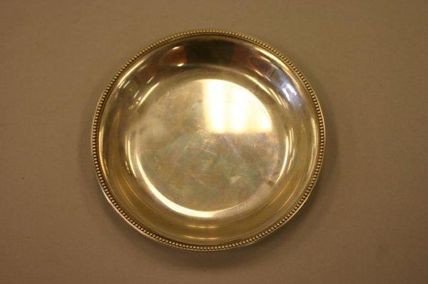 3022: Tiffany & Co small circular sterling tray. 4.
