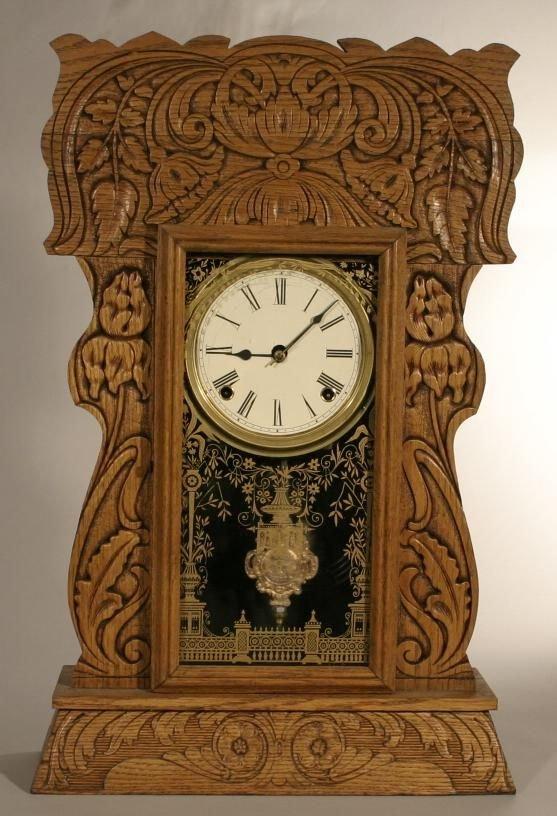 """10: Pressed oak """"Gingerbread"""" case shelf clock, with"""