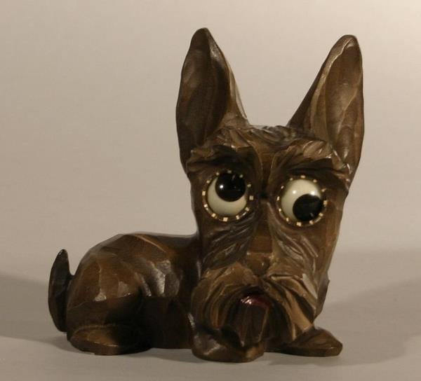 16: Molded Scotty dog bovelty clock, with revolving e