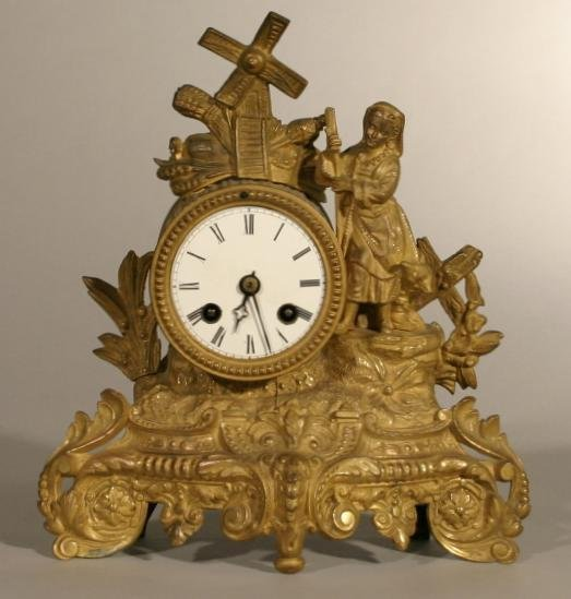 20: French gilt metal mantle clock, with dutch girl &