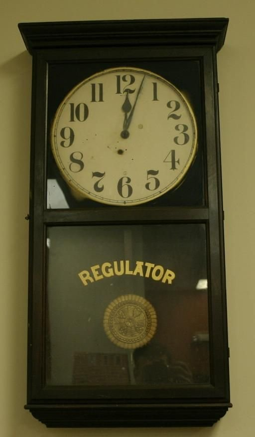 22: Sessions regulator wall clock, c. 1920, 35.75'h x