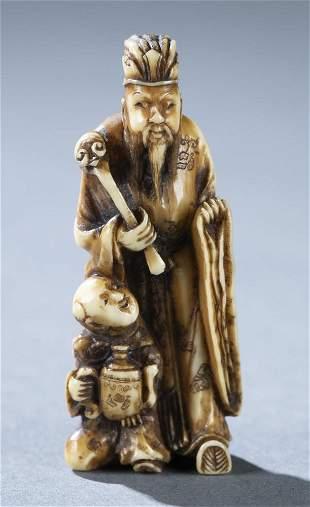 Netsuke of a scholar and a karako 19th c