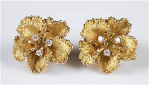 18k Gold & diamond flower earrings.