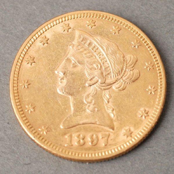 3126: 1897 Eagle $10 gold coin.