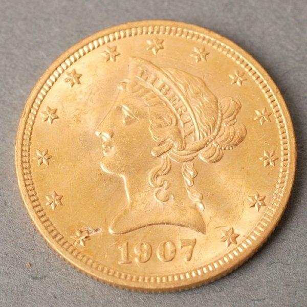 3127: 1907 Eagle $10 gold coin.