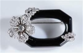 Dirce Repossi 18k gold & onyx diamond brooch.