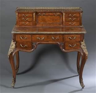 Louis XV style burlwood desk.