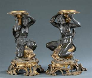 Pair of Bronze figural candle holders, 19th c.