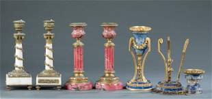 3 Pairs of stone and bronze candlesticks.