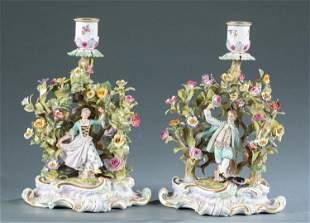 2 Meissen porcelain figural candlesticks.