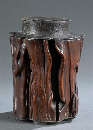 Bronze cylinder tea jar with wood cover.