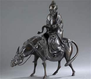 Japanese bronze of a scholar riding an ox, Meiji.