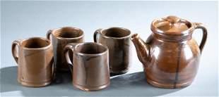 Norman Smith teapot and 4 mugs.