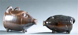 Norman Smith, 2 pottery pigs.