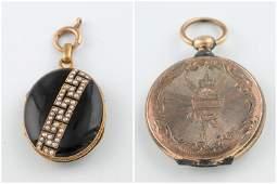 2 Gold lockets.