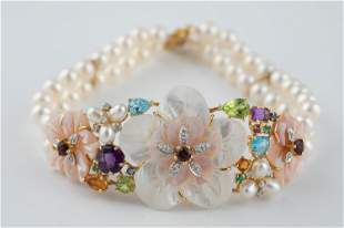 18k Pearl and multi colored gem bracelet.
